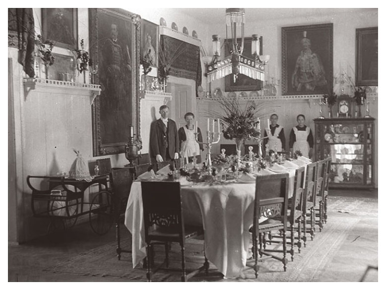Servants in the dining room of a noble's estate