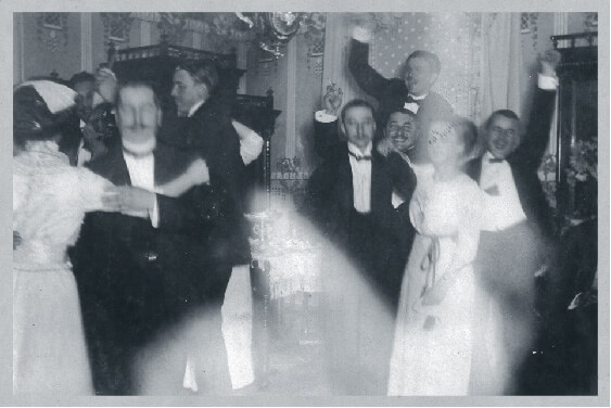 Wealthy Hungarians dancing at a party far away from the fighting