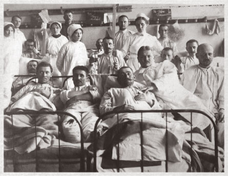 Wounded Austro-Hungarian soldiers recovering in a war hospital with nurses in the background