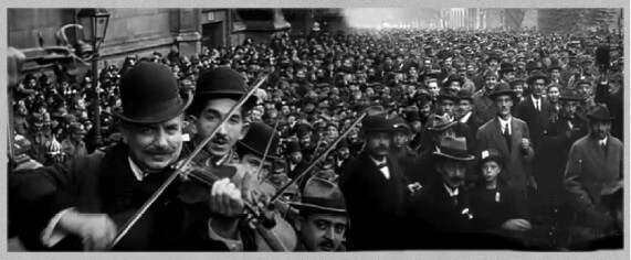 Violinists playing in front of crowd in Budapest in 1918