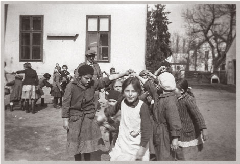 Children in front of their school in Gomba Hungary