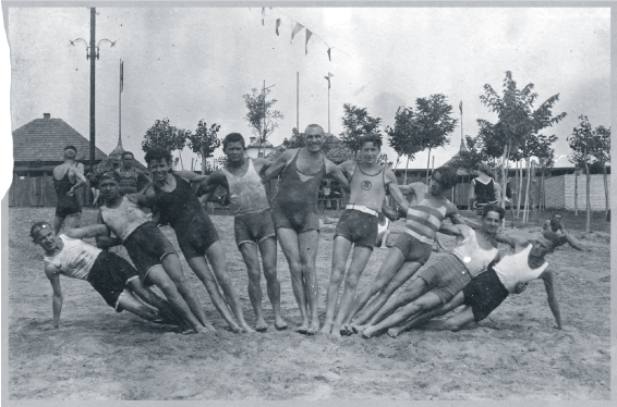 Upper middle class vacationers on Lake Balaton in bathing suit rainbow formation in 1920