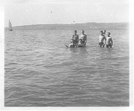 Gyula with Ari and cousins standing thigh-deep in the shallow waters of Lake Balaton in 1940