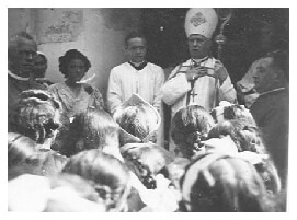 Bishop visiting Marcali Hungary and addressing small crowd in 1940
