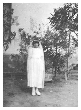 Ari posing in her Communion dress in Marcali Hungary in 1940