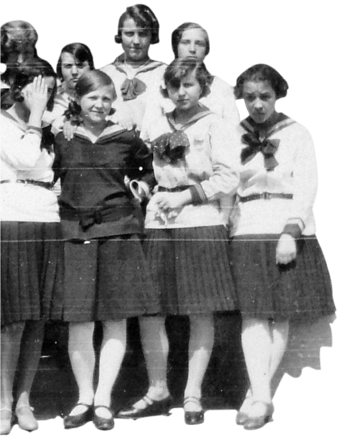 Hungarian Catholic girls in uniform waiting in line to enter their school