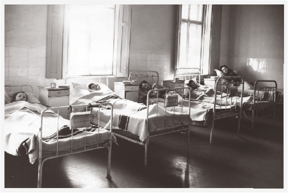 Hungarian teenage girls in beds at a boarding school