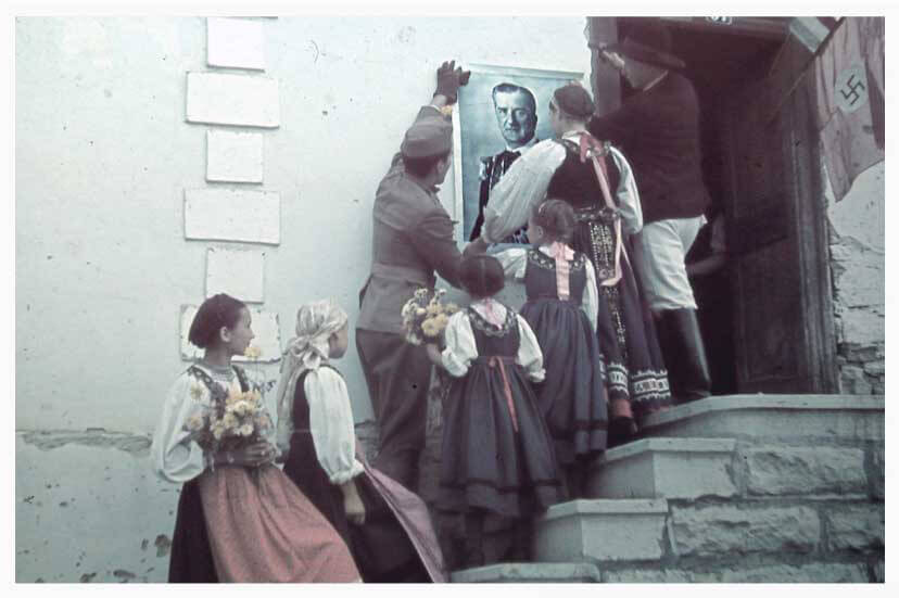 Hungarian troops hanging a large poster of Miklós Horthy in Nagydemeter Romania in 1940