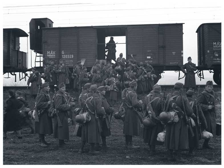 Groups of Hungarian soldiers in front of empty railway cars in 1941