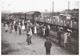 Hungarian soldiers in railway cars and civilians waving goodbye in 1942