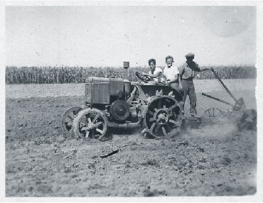 Gyula with cousin Géza on a tractor in Marcali Hungary in 1944