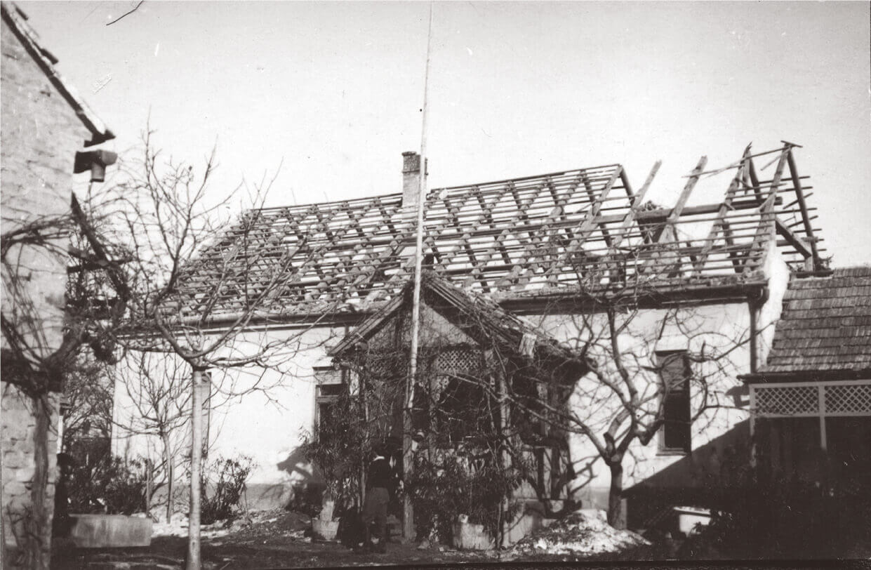 Repairing the bombed roof of the Fábos house in Marcali, 1945