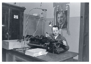 Communist Party member fixing a typewriter