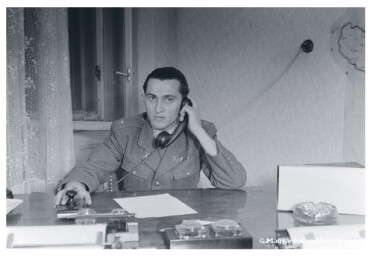 Communist Police officer on the telephone