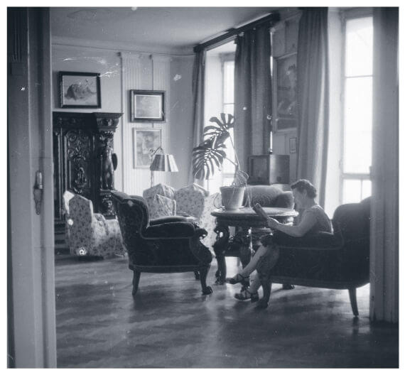 Woman reading a magazine in an elegant living room