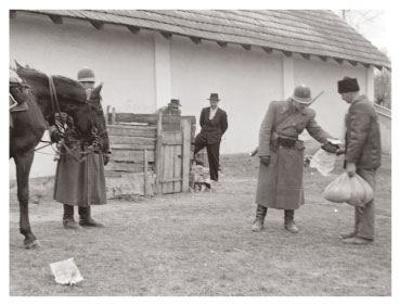 Police inspectors checking bags of grain during the Rákosi era