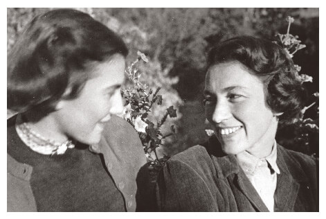 Two women friends smiling in Hungary in 1953