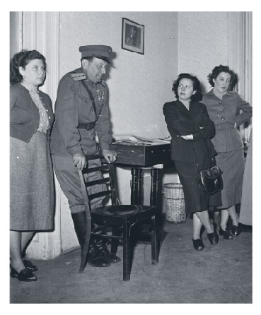Hungarian gathering with communist policeman in 1955