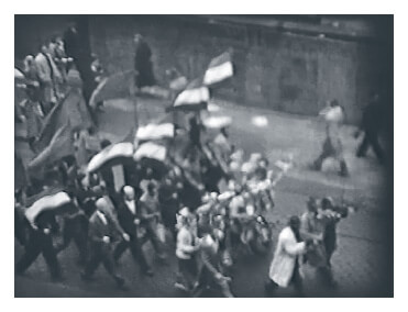 First of two Video clips showing peaceful marching on the first day of the 1956 Hungarian revolution