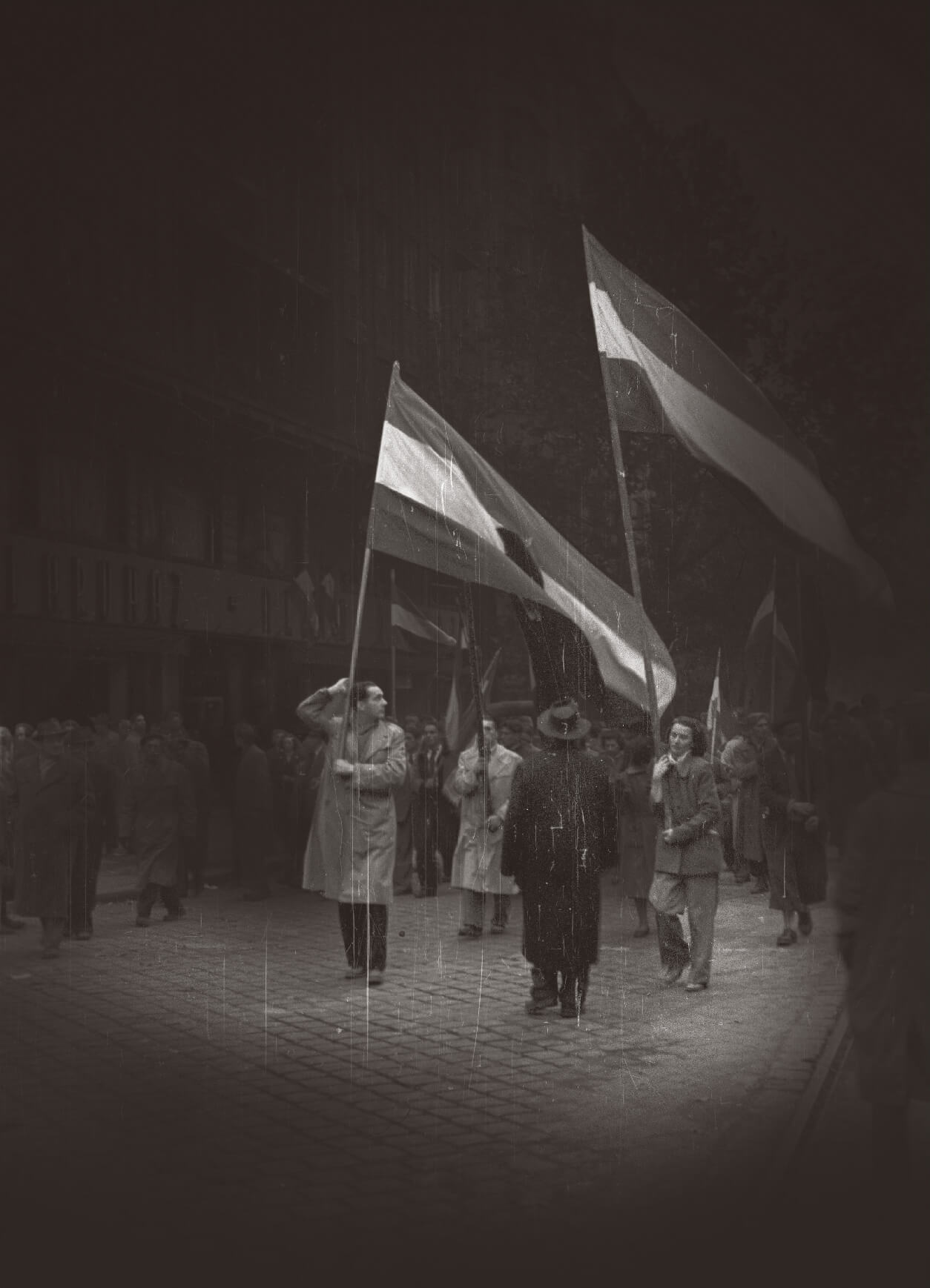 Carrying flags during the 1956 Hungarian Revolution
