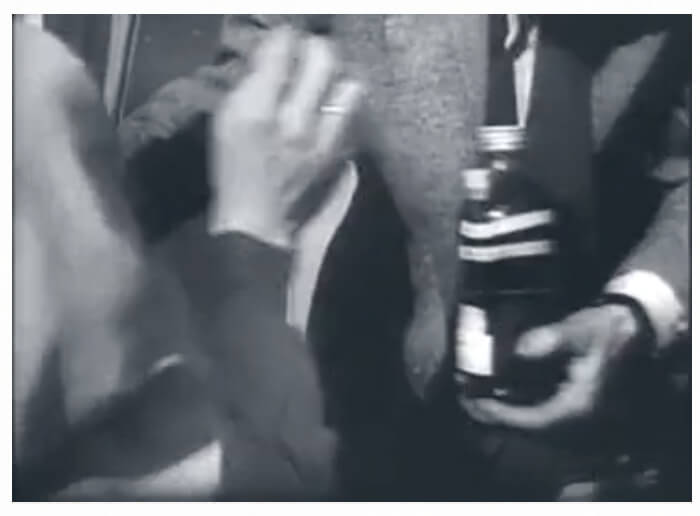 Video footage showing freedom fighters passing along Molotov cocktails during the 1956 Hungarian Revolution