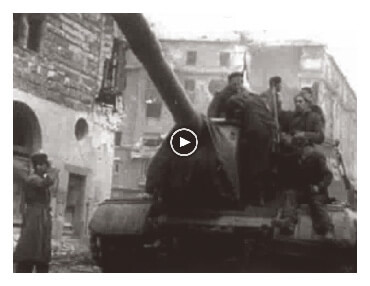 Looped video footage showing Hungarian freedom fighters atop a Soviet tank and advancing towards the viewer