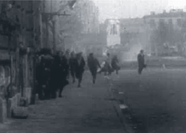 Looped video footage on the right side of the screen showing Hungarians running to escape gunfire