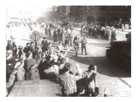 Looped video footage showing jubilant Hungarian revolutionaries celebrating on captured Soviet tanks during the 1956 Hungarian Revolution.