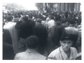 Looped video footage showing a Budapest crowd full of energy, anticipation and anxiety during the 1956 Hungarian Revolution