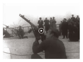 Looped video footage showing Hungarian Freedom Fighters shooting at Soviet air forces flying overhead