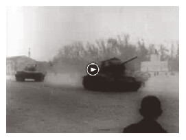 Looped video footage showing Soviet tanks entering Budapest