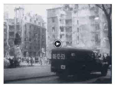 Looped video footage showing Medics running to assist people during the 1956 Hungarian Revolution.