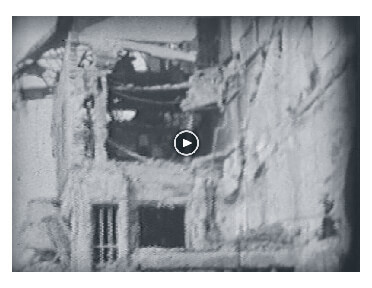 Looped video footage showing Bombed buildings