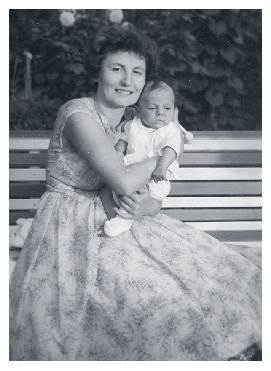 Ari holds baby Laci in 1960
