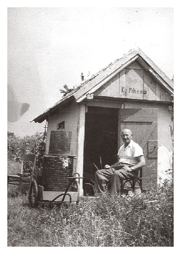 Pista sits by his farming shack around 1970