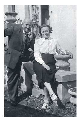 Pista and Gizi sit on a stoop by their house in Keszthely in the 1960s