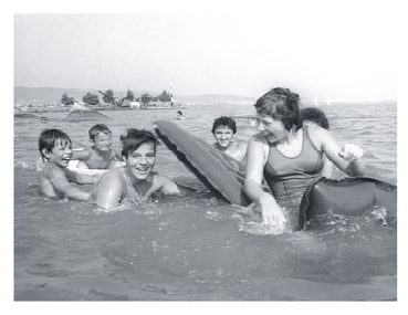Laci splashes in Lake Balaton with Adrian and Anita and other friends in 1976.