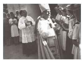 Bishop leading Catholic procession downtown Marcali in Hungary 1940s