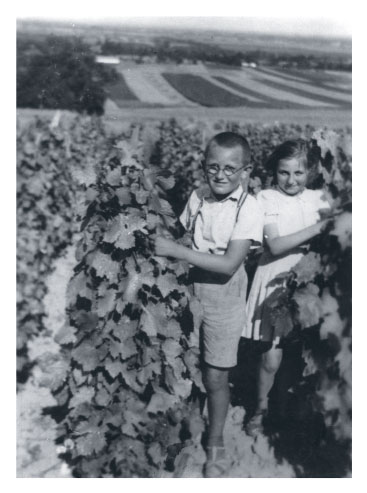 Ari and Gyula on the family farm in Marcali Hungary 1940s