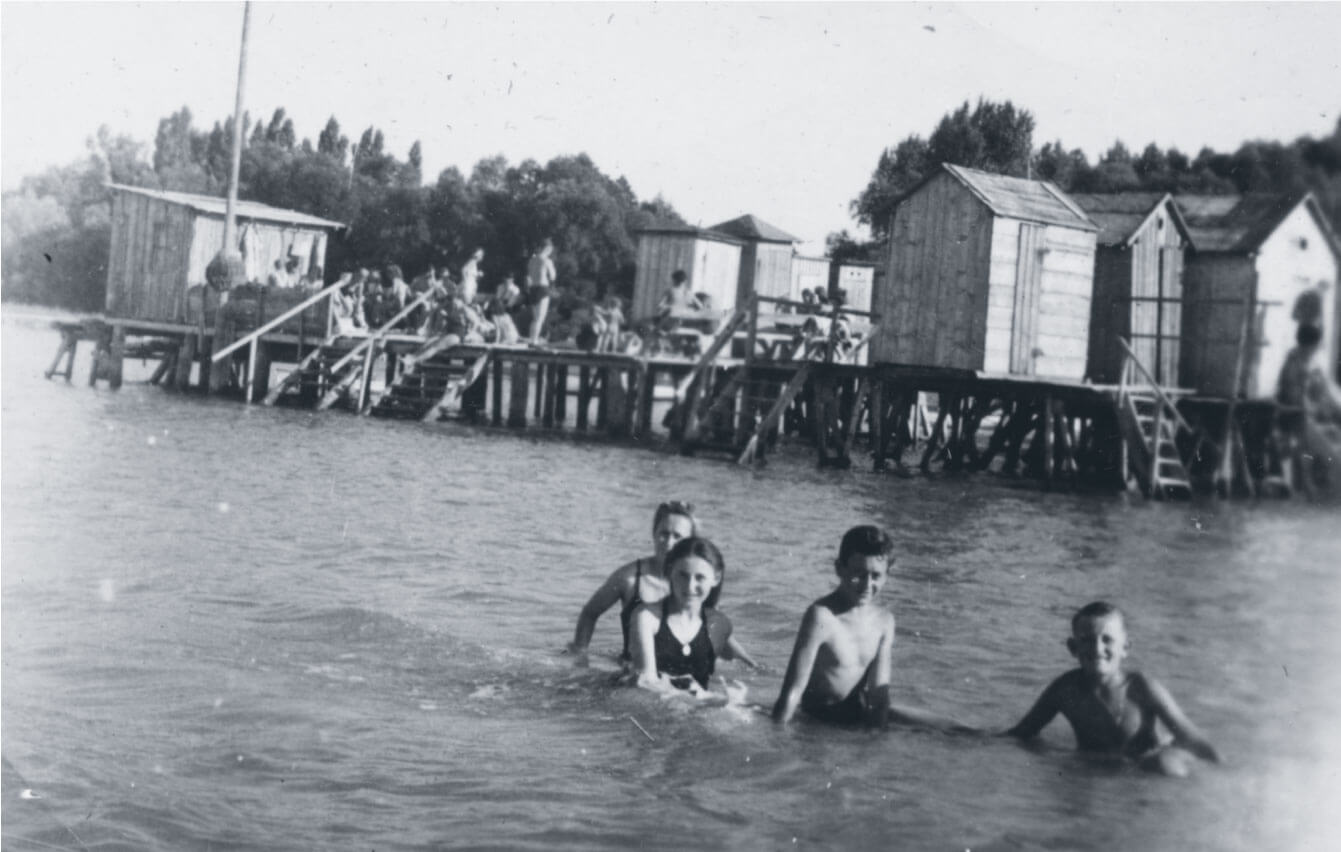 Ari and Gyula swim in Lake Balaton with their cousins during the 1940s
